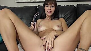 Reaching quick climax by using glass dildo
